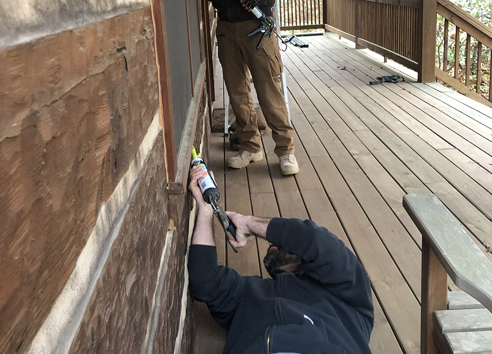 Our team doing a bat seal-up on a Cabin near Greensboro